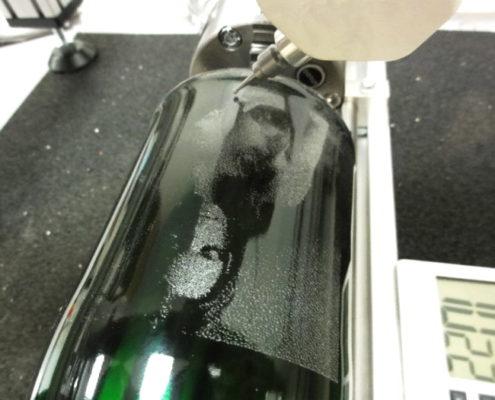 Foto graveren op glazen fles